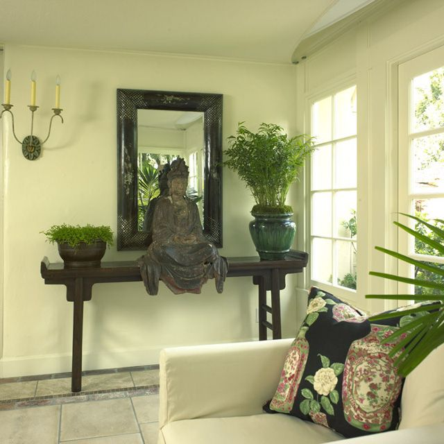 buddha themed living room buddha sits on a high table overlooking a simple set up 14705