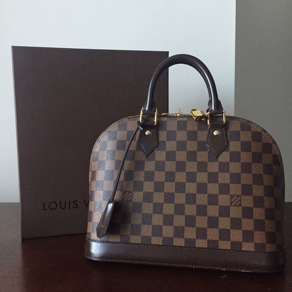 Louis Vuitton Damier Alma PM WITH RECIEPT Just really outgrew the purse. I only took it out on certain occasions. I'm a huge fan of my neverfull. This one is the medium size one. No stains. Comes with key, lock and dust bag plus large gift box. Paid over $1200 for this when I was a casino executive in Vegas. NO TRADES. NO LOWBALL OFFERS. Added more photos Louis Vuitton Bags
