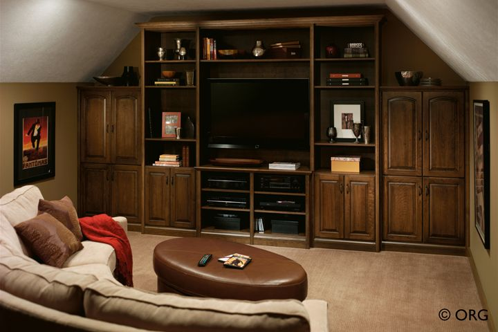 Why settle for ordinary when you can have this extraordinary media center personalized for your style and family's entertainment needs. Crown and base moldings, and custom design features add a traditional touch to match your home décor.