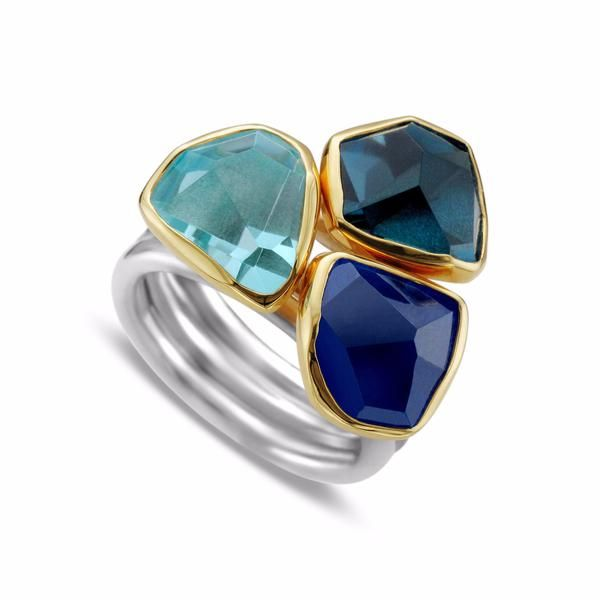 While wearing this ring you feel like Athena, Goddess of wisdom, knowledge and art. All eyes are upon you as they witness your strength and grace. Aquamarine, Tanzanite, and London Blue Topaz - 15.10C