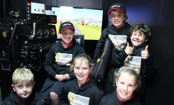 Waimairi School students learned what it takes to bring a train to a stop, by having a go themselves on the controls of a realistic simulator. The portable simulator, housed in a converted freight container, is used by KiwiRail for training drivers. The students visited the simulator in Christchurch during Rail Safety Week. It is fitted out inside like the cab of a real locomotive, with controls including throttle and brake, and a computer screen that simulates the view ahead along rail…