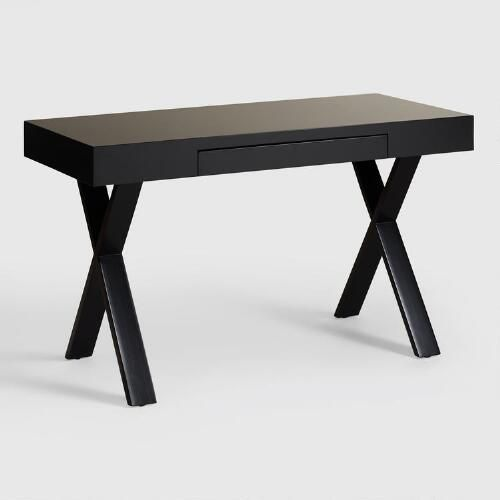 "The crisp lines and ample tabletop of our Black Josephine Desk make it one of our favorite stylish spots to sit and get things done. In bright, high-gloss black with ""X""-shaped legs, and complete with a handy keyboard tray, it combines pretty with practical for a show-stopping look that's thoroughly functional."