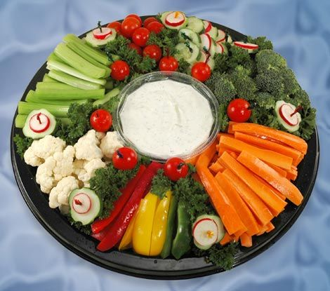 veggie tray:  middle is green pepper with dip inside, dip is greek yogurt/mint/lemon juice/olive oil/salt/minced garlic with little cucumber squares on top, outside of broccoli is tomato, on top of everything is shredded carrots