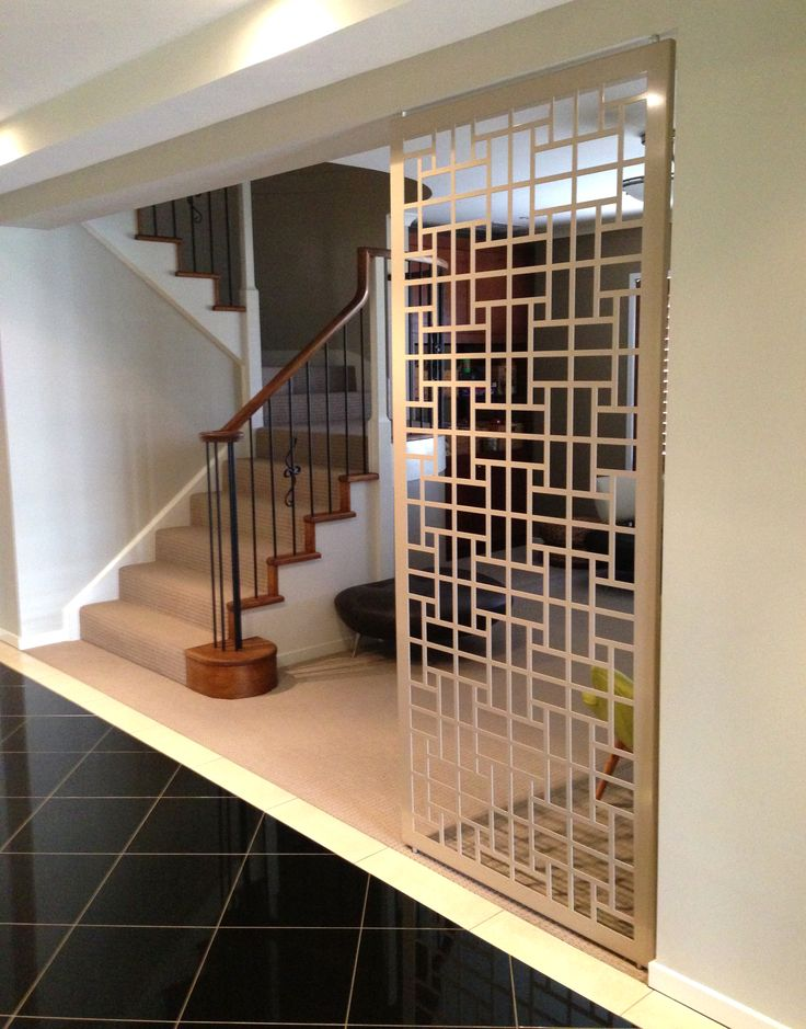 Decorative screen room divider between foyer and lounge for Painted screens room dividers
