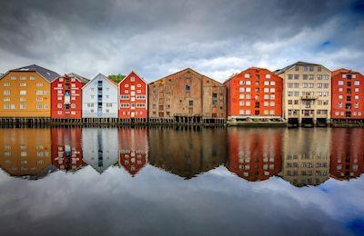 Håkan Johansson - Trondheim. Colorful houses on waters edge.