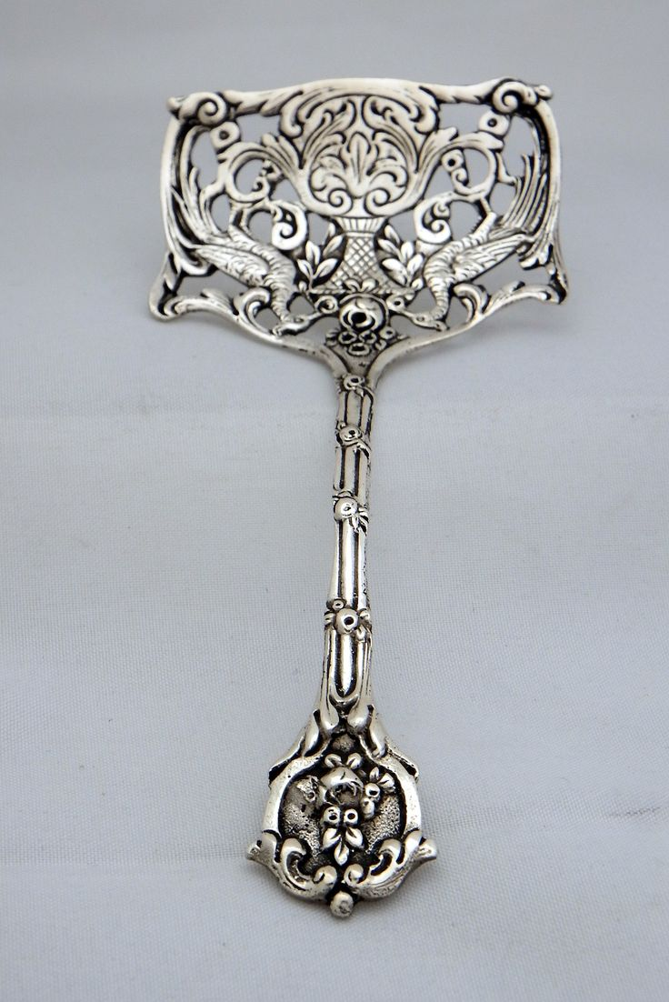 This is not your standard silver serving piece - would be great for nuts or candies on your table: 800 Silver Sardine Server - by Unknown www.gryhponestatesilver.com