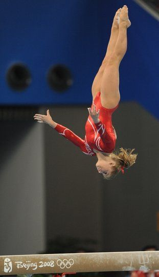 Atlethes gymnastics. Shawn Johnson  on balance beam at Beijing 2008, Olympics. This is done on a 4 inch wide beam that is 4 feet off the ground.........