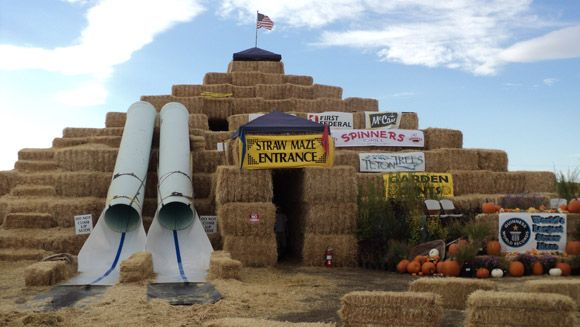 Amazing. A straw bale maze with a 3 story pyramid at its centre, ladders and slides. It is the official world record holder and is in Idaho. The maze used 3,202 bales of straw, with each bale weighing an approximate 1,100 lbs.The maze features 1.6 miles of pathway, both on the ground and in the elevated 3D section.  Wow.
