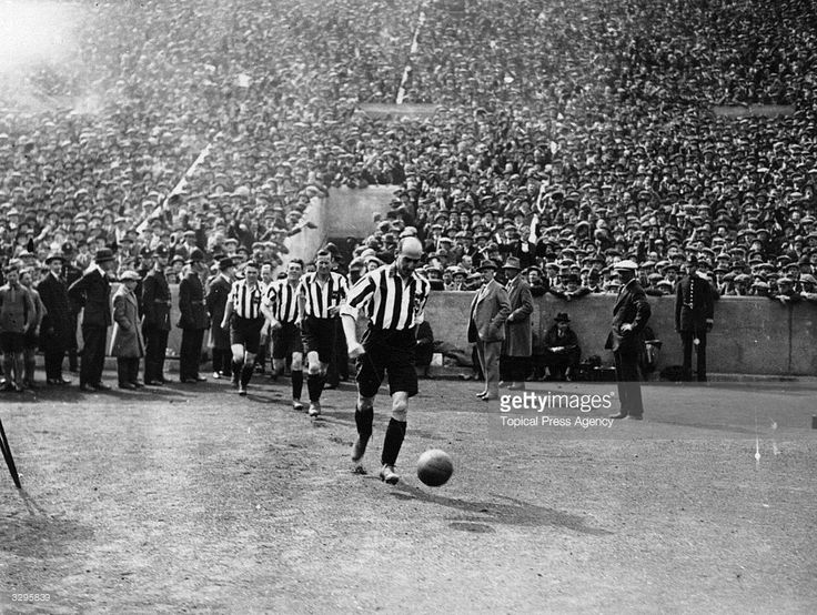 The Sheffield United FC team take the field at Wembley Stadium, north London, for the FA Cup Final match against Cardiff City. Sheffield United went on to win the match with a 1-0 victory.