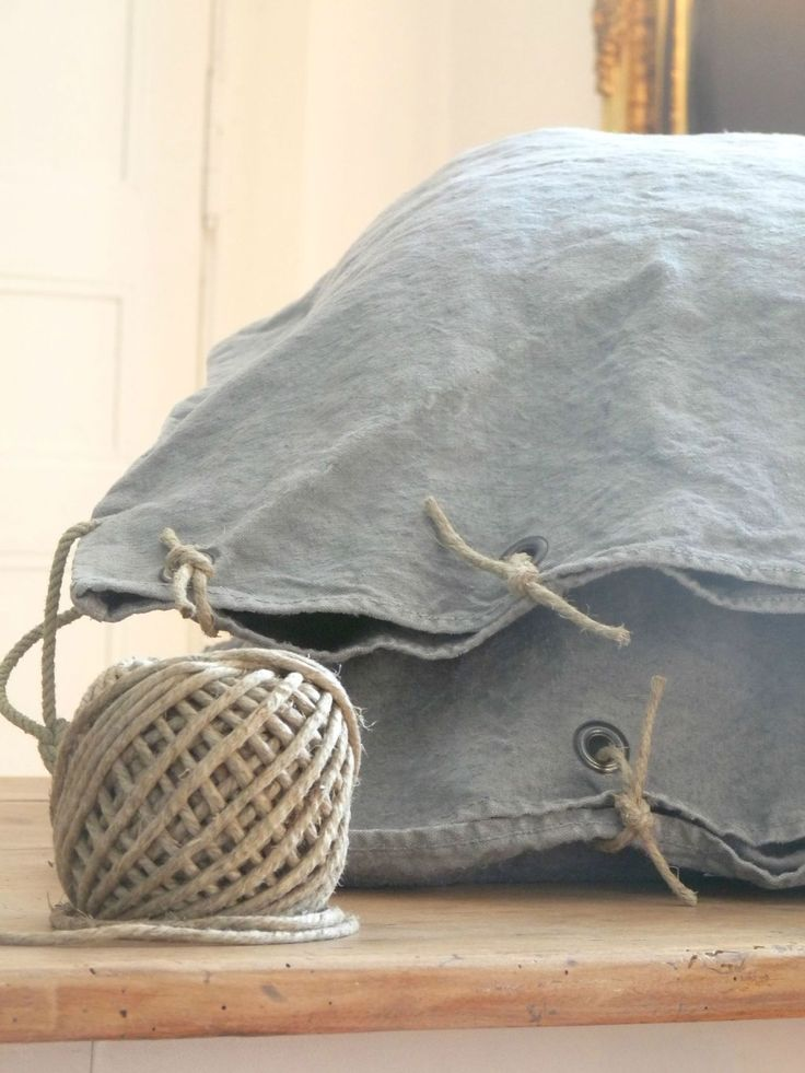 Not in English, but the idea is clear: punch grommets into denim and use hefty twine to create a rustic pillowcase.