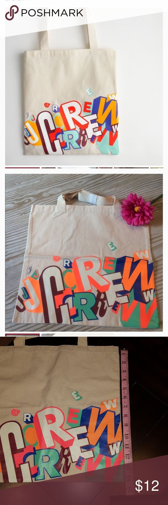 """J crew Tote bag Based on graffiti by Greg Lamarche outside of J. Crew Brooklyn. Cotton canvas bag. 14"""". Never used. Considered """"NWT"""" but did not come with tag J. Crew Bags Totes"""