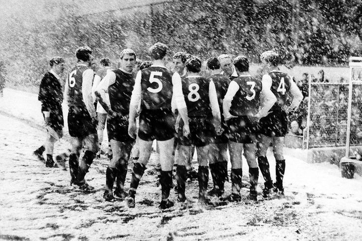 Sheffield Wednesday players gather on the side line at Highbury during their match against Arsenal. The match was abandoned after 47 minutes...