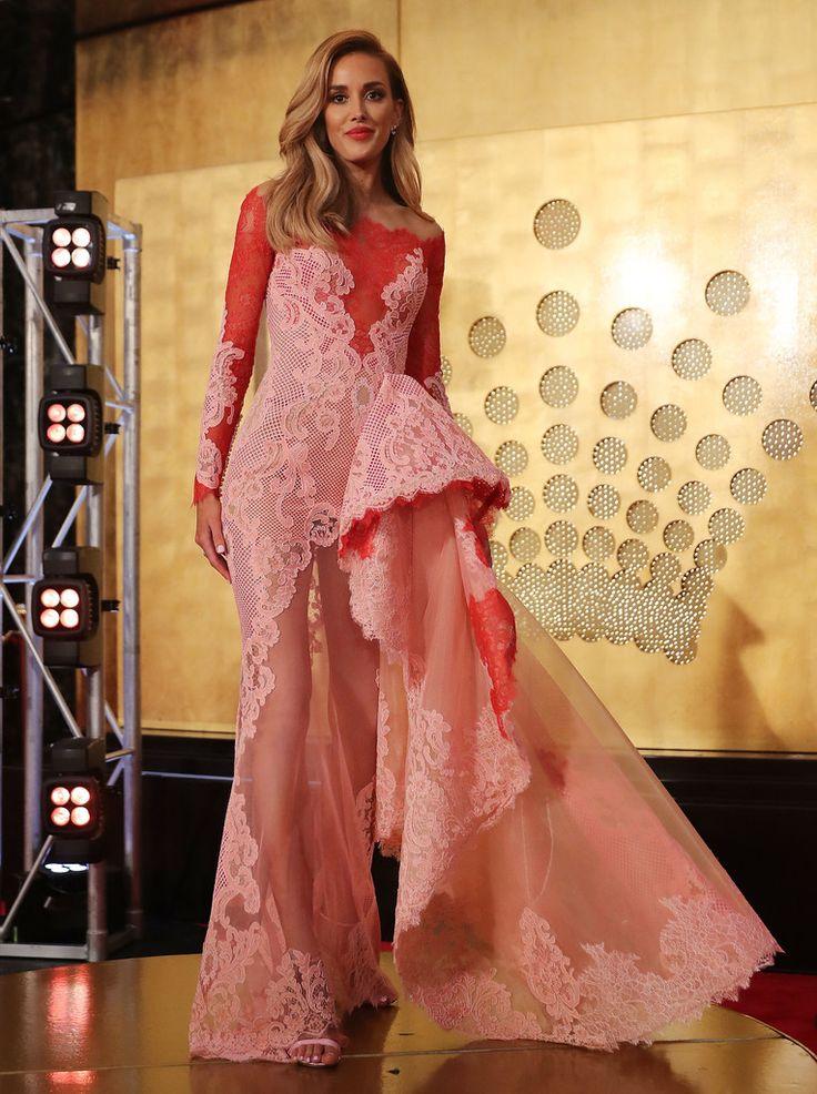 Rebecca Judd.. bespoke J'Aton Couture gown, with paulbramdiamonds rings, olelynggaardcopenhagen earring cuff, and Gucci heels..