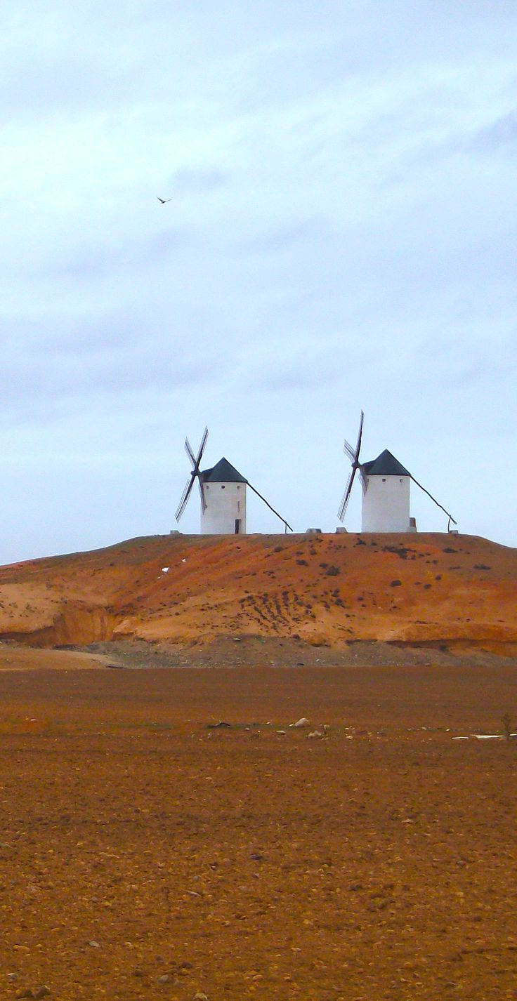 La Mancha Spain: very few of these windmills remain in the country. They are powerful witnesses to the ancient and rich history and architecture of Spain