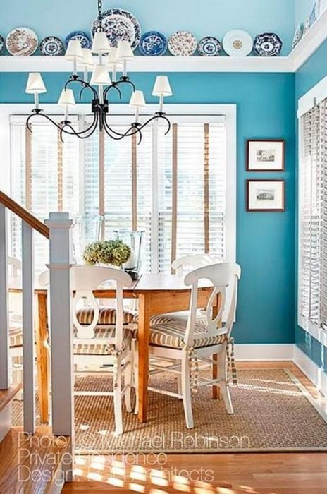Pretty turquoise dining room - even though it's bright, I rather like it!
