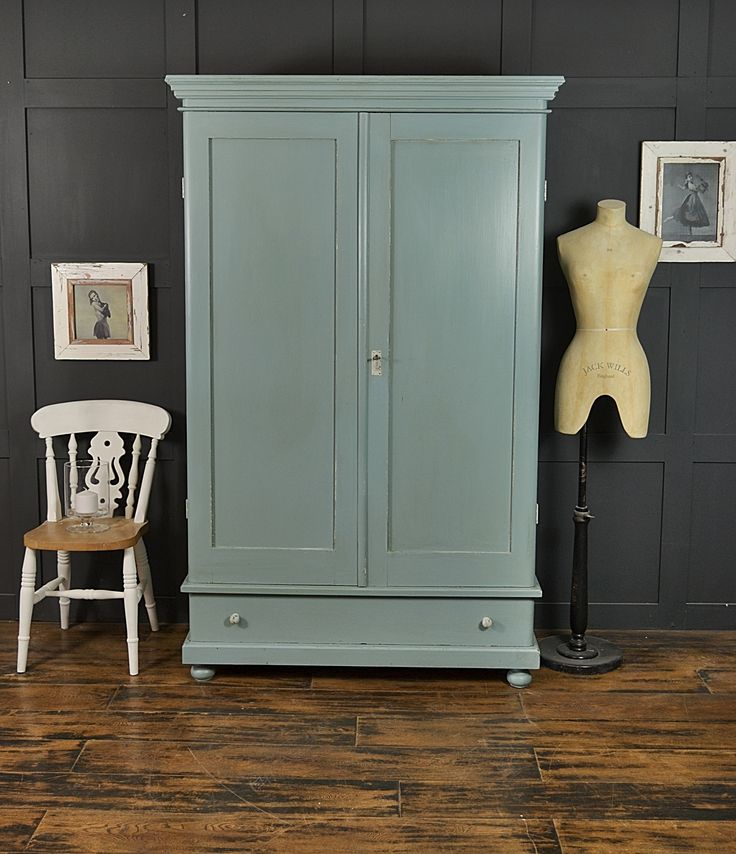 This beautiful antique wardrobe from Holland has ample storage space with drawer and hanging space. The doors wrap around to create a stunning curved front. We've painted the inside in an Annie Sloan Old White wash, with the main body in Farrow & Ball Oval Room Blue.  Comes with FREE UK DELIVERY! http://www.thetreasuretrove.co.uk/bedroom-storage/farrow-and-ball-oval-room-blue-antique-shabby-chic-wardrobe