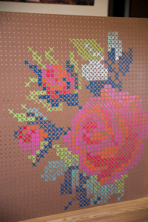 diy cross stitch pegboard...the possibilities...large scale artsy even alterable serious or kid-made...a play on a hanging tapestry...