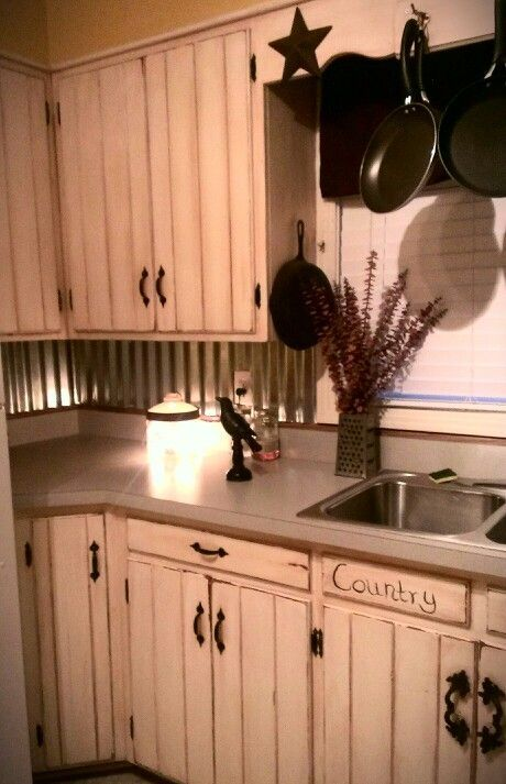 Rustic kitchen -tin backsplash