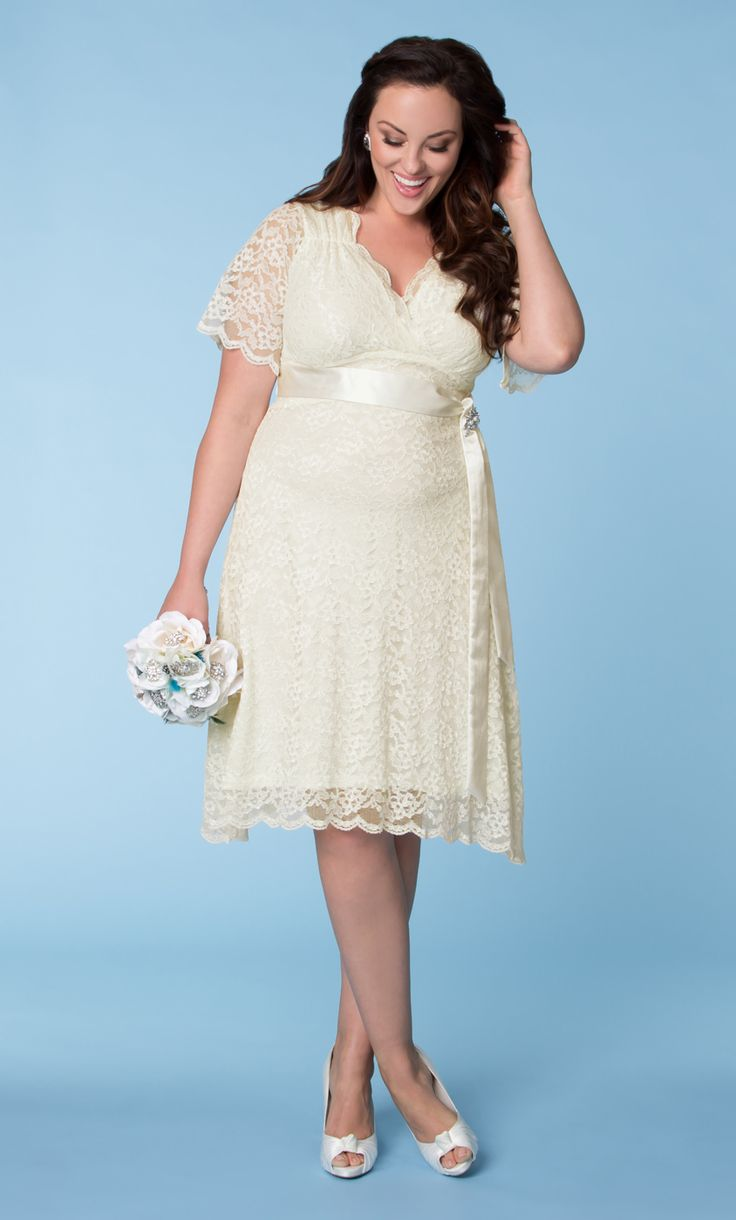 Looking for a vintage, old Hollywood type of vibe for your big day?  Check out our plus size Lace Confections Wedding Dress.  Flattering sweetheart neckline, a flowy A-line skirt and a removable satin sash creates a fantastic shape and look.  For sparkle, we've included a rhinestone and pearl encrusted brooch.  #KiyonnaPlusYou  #Plussize  #Kiyonna