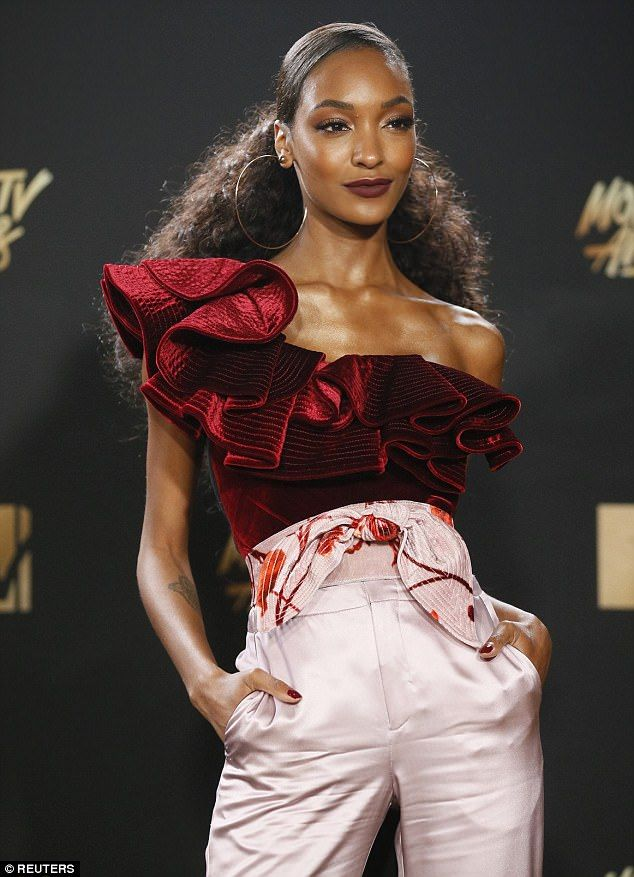 Clashing:The mother-of-one, 26, opted for a mismatched top and trouser combo of burgundy velvet and pale pink silk, clashing both in colour and fabric