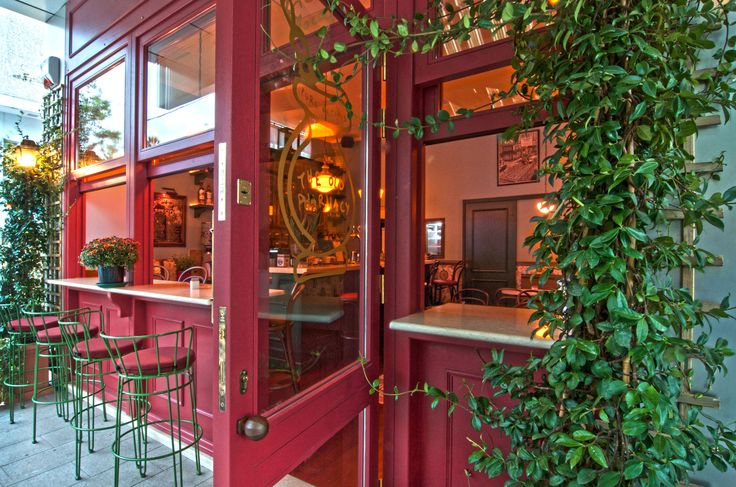 Red, Wooden Window Casing | Retro bar facade by AkPraxis. To see the whole project visit http://www.akpraxis.gr/portfolio/old-pharmacy #old_pharmacy #bar #exterior  #design
