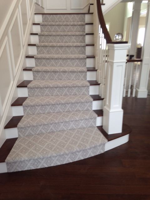 We love this stunning patterned stair runner in a soft beige.   If you're looking for a patterned product to warm up your staircase, browse our carpet catalog: http://www.americasfloorsource.com/product/carpet/