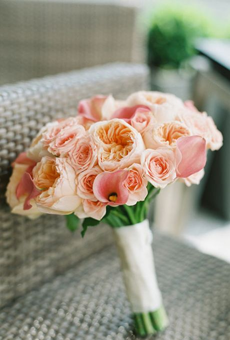 Brides.com: 15 Pretty Peach Bouquets. Peach bouquet of Calla lilies, Juliet garden roses, and spray roses from Verde Flowers.