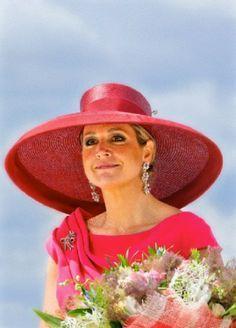 Queen Maxima in stunning wide-brimmed hat.