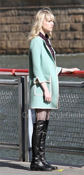 Seen on Celebrity Style Guide: Emma Stone wears celebrity favorite Stuart Weitzman 50/50 Over The Knee Boots while filming scenes for The Amazing Spider-Man 2 by a dock on Sunday afternoon (May 5) in New York City.