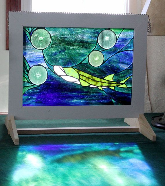 Lake sturgeon stained glass window. This window can hang or stand on its own. Designed and made by Merissa Geldner