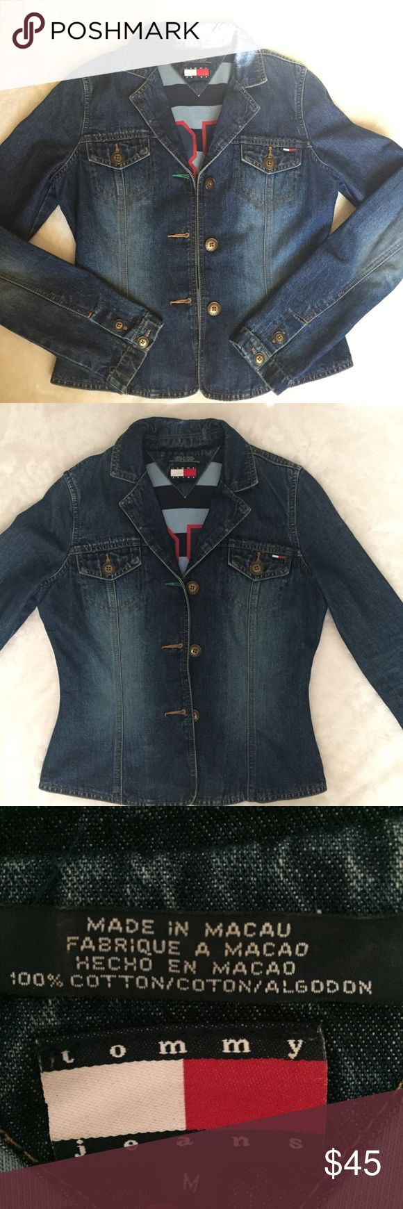 """Vintage Tommy Jean Denim Jacket Length: 20""""... Bottom Hem: 24.5""""... Shoulder:  14.4"""" Sleeve length: 24.5""""...  Says Medium but fits like a Small. Has 85 logo inside the jacket. Has a tiny stain shown in the 5th picture and also on the back as shown in 7th picture. Other than that this jacket is in good condition. Tommy Hilfiger Jackets & Coats Jean Jackets"""