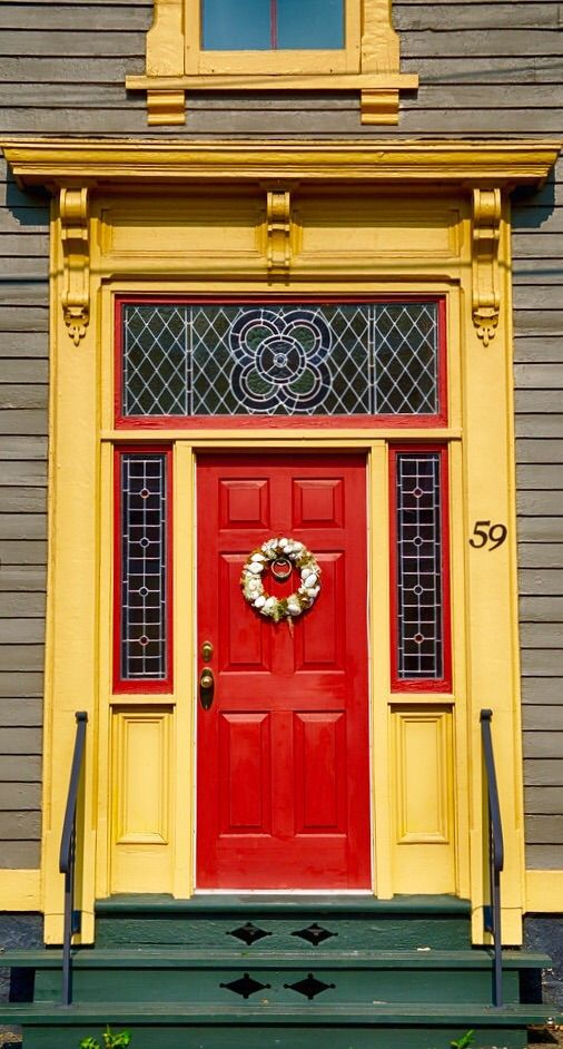 bright door with stained glass.  Lunenburg, Nova Scotia, Canada