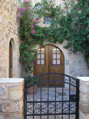 Residence in a medieval seaside town. This doorway is located in Monemvasia, Greece.