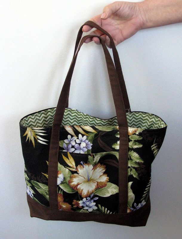 """Hawaii. Each one is unique!  When open measures 15"""" x 12"""" x 4""""   Fully Lined   Can be reversible   Straps are reinforced and go all the way to the bottom   Double panel on bottom   Square bottom   Inside Pockets   Outside Pocket   Scotch guarded to repel stains  *Customers can provide pictures of their pets, cars, etc. for personalized lining material at an extra cost of $10"""