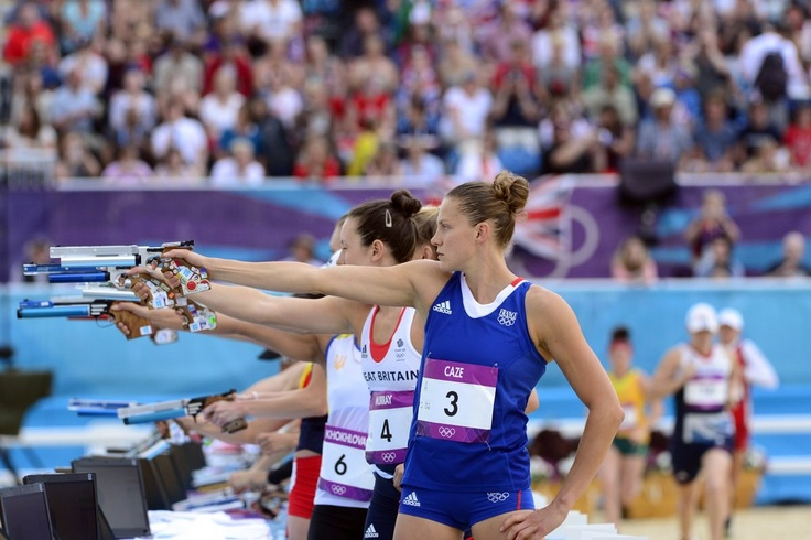 France's Amelie Caze, flanked by Britain's Samantha Murray, aimed during the shooting portion of the women's modern pentathlon.