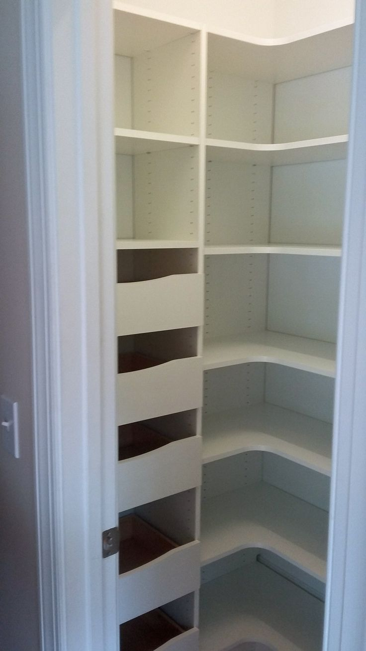Maximize storage in a small pantry closet with corner shelving and drawers. Ample space for