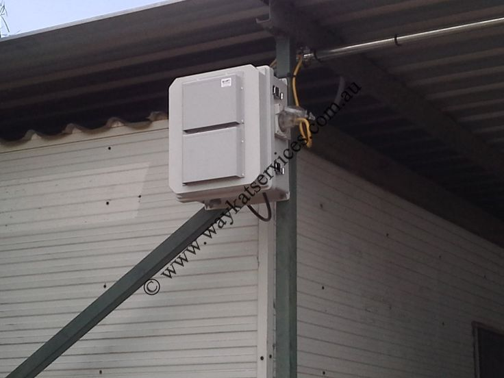 A close up view of the I.P. rated weather enclosure housing the Telstra NextG RS/2 W/U Cel-Fi repeater looking 45M's across to the main tractor workshop providing Telstra NextG voice and data communications mounted on the main frame of the ATCO accommodation.