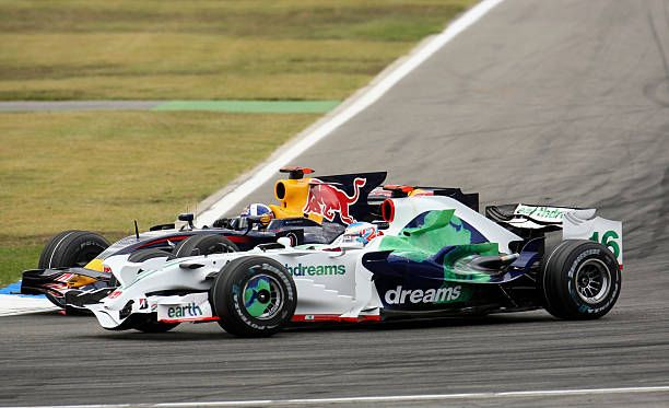 Jenson Button of Great Britain and Honda Racing leads from David Coulthard of Great Britain and Red Bull Racing during the German Grand Prix at...
