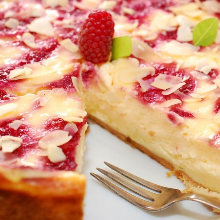 A creamy and delicious white chocolate pie recipe topped with tangy sweet raspberries.