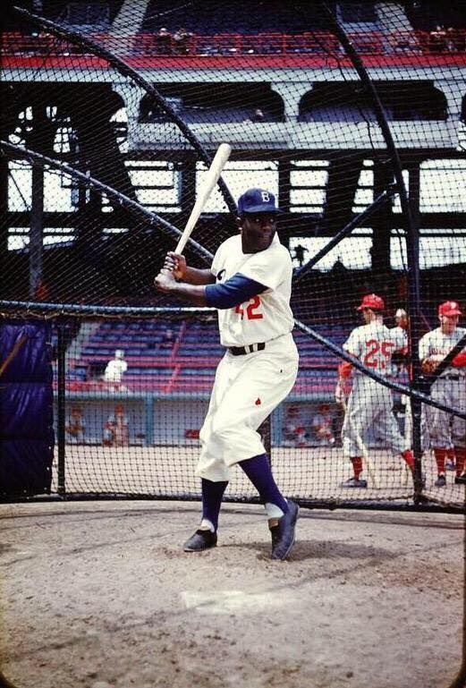 Rare color shot of Jackie Robinson taking some BP at Ebbets Field.