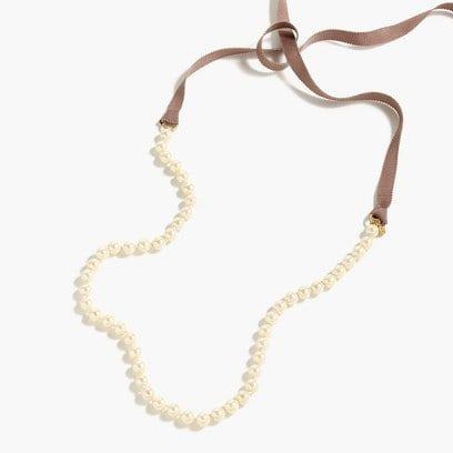 Ribbon-tied long pearl necklace
