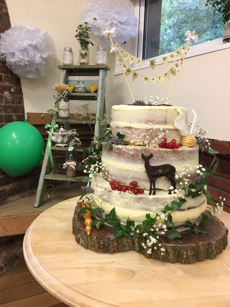 Beautiful naked cake made by my sister for my daughters wedding last weekend . Little nod to her love of Harry Potter . It was a delicious carrot cake , lemon and poppy seed and Victoria sponges .