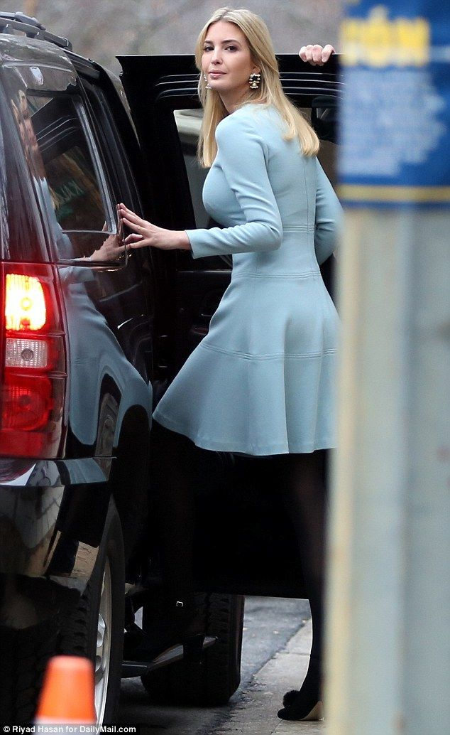 Greeting the day: Ivanka Trump was seen heading out of her house in the upscale neighborhood of Kalorama in Washington, D.C. this morning, wearing a long-sleeve blue dress