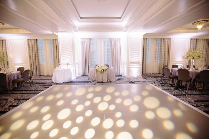 A popular and eye-catching addition to wedding receptions, event planners at The Ritz-Carlton, San Francisco use a pattern-wash of lighting to make the dance floor even more inviting.