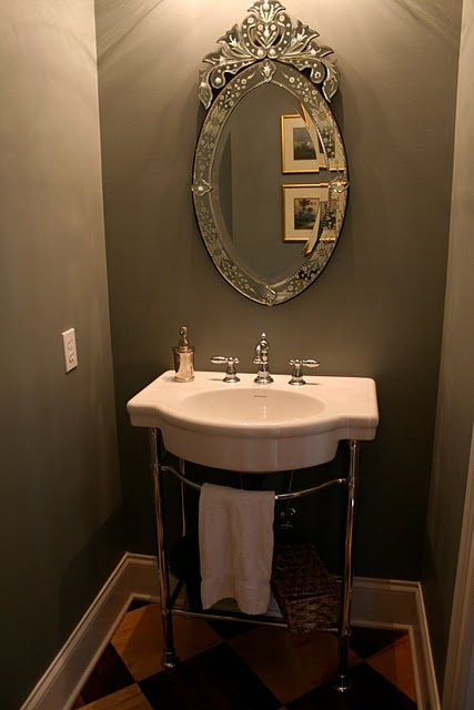 1/2 bath pedestal sink and checkerboard floor on an angle......mirror........
