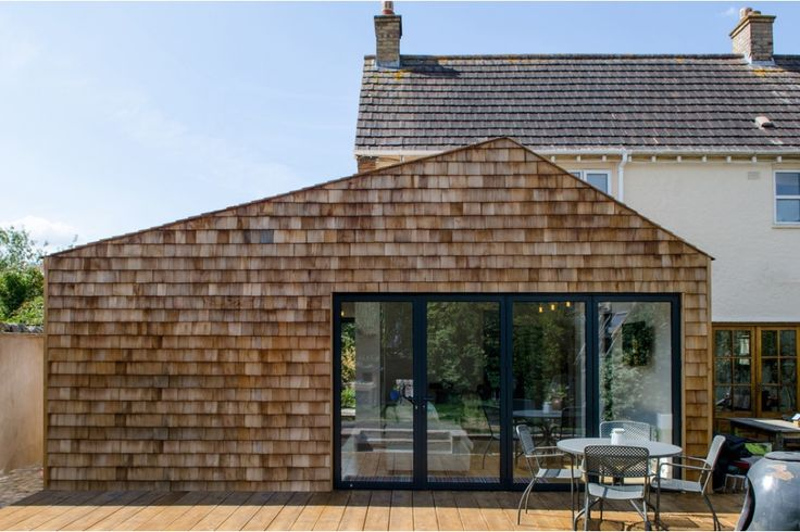 a-symmetric roof pitch, timber shingle, extension