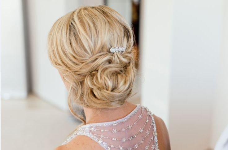 Elegant and simple bridal updo / upstyle for a dress that needs an open back.  ~ Image Property of Darren Bester Photography