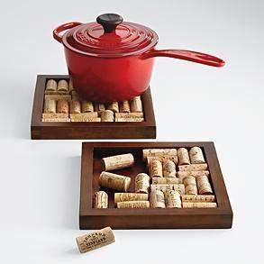 Old wine corks glued into a wooden picture frame = pot holder