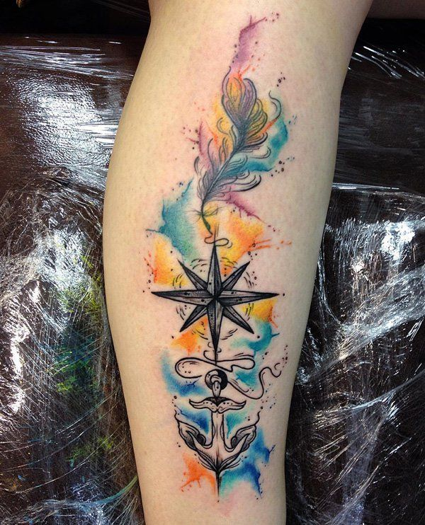 This is a beautiful watercolor tattoo of three different things with different meanings. Usually an anchor means loyalty and stability, a compass would represent direction and a feather are generally symbols of freedom.