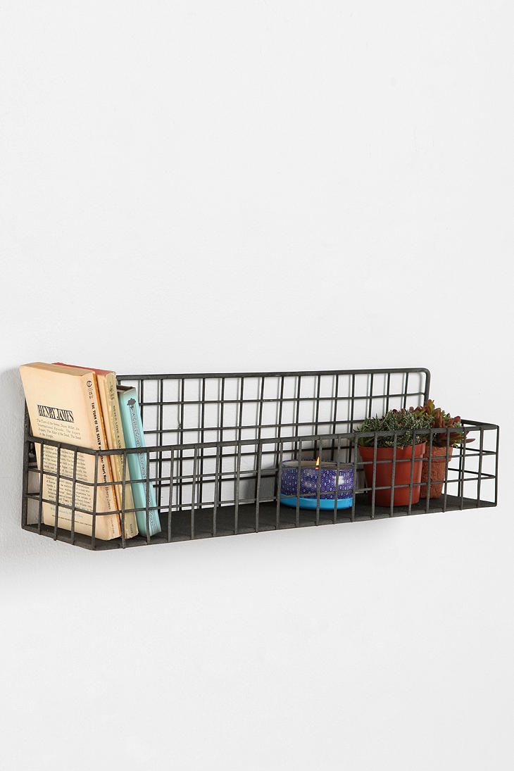 Grid Wall Bin #UrbanOutfitters for over their beds with books in them. Says its not for books but kids books are lighter, smaller